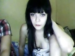 Two naughty dark haired webcam lesbos undress and tease titties