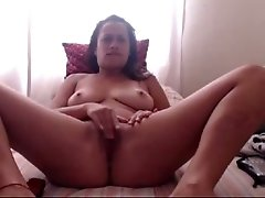 Dark haired ugly as shit webcam mature lady was teasing her own slit
