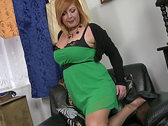 Mature tattooed buxom blonde MILF Alex strips at home