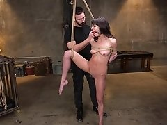 Cute amateur brunette Lexi Foxy has her tits abused while strapped in