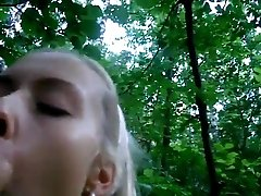 Hot blonde blows her boyfriend in the woods