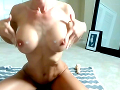 Fit Gym brunette oils up her big tits and tight ass. She has a sweet pussy with a big clit.
