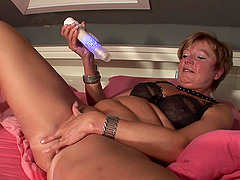 Ina V. sucking her toy before putting it in her cunt