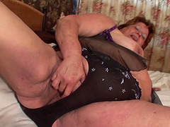 Brigit is a large lady who enjoys loosing her hand between her legs