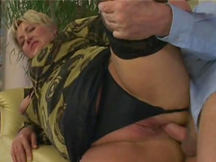 Bald fella tasting a mature babe in sexy stockings and bashing her