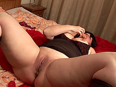 Chubby mature woman Gertie plays with her throbbing cunt