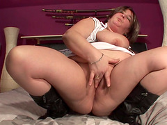Plump Jannie V. fucking her own cunt with a sex toy