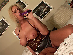 Celine S is a curvy blonde who loves riding her sex toy